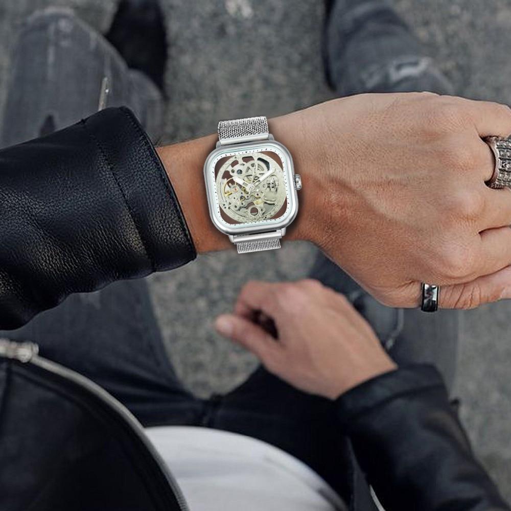 H6d5ae308c360451cbf3ac4dee6144a88Y FORSINING Top Brand Luxury Unisex Watch Men Auto Mechanical Hollow Dial Magnet Strap Fashion Royal Wristwatch HIP HOP Male Clock