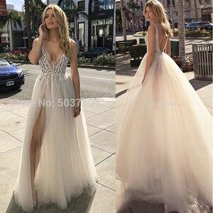 Image 1 - קיץ שמלות כלה 2020 עמוק V מחשוף חרוזים גבוה פיצול ללא משענת קו טול שרוולים Boho כלה שמלות Vestido Noiva