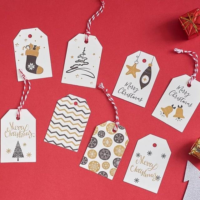 100 adet/grup beyaz noel kağıt etiketleri bagaj düğün not boş fiyat etiketi asın Merry Christmas hediye kartı halat 6.8*4.5cm