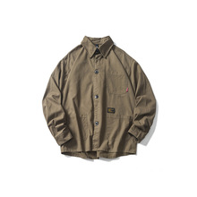 Japanese Streetwear Loose Multi-pocket Solid Color Shirt Male Designer