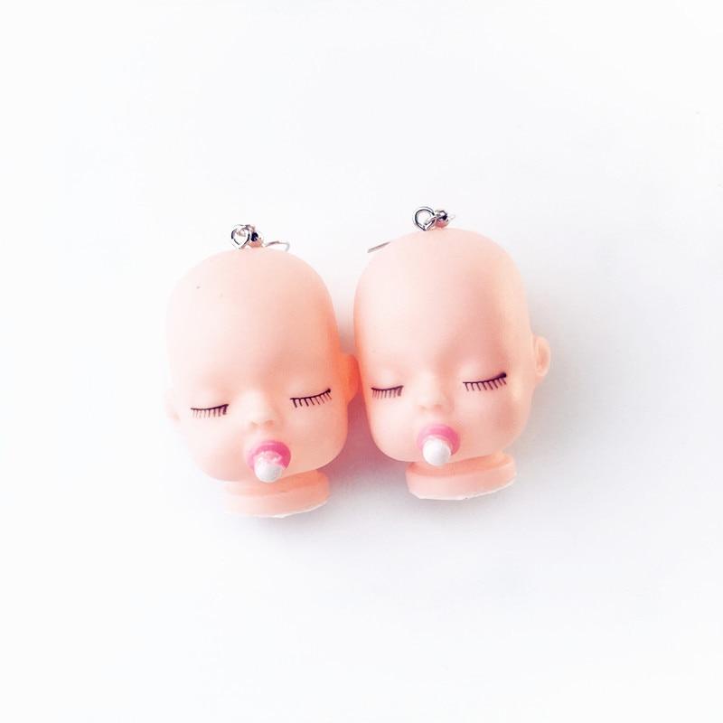 Sleeping Baby Head Earrings 2