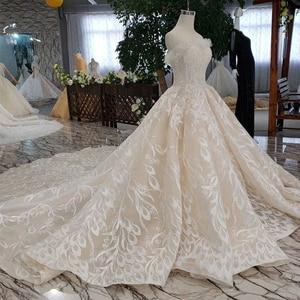Image 3 - Bgw HT5620 suknie slubne 高級セクシーなストラップレスのウェディングドレスレースシャンパンアップリケ夜会服のウェディングドレス結婚式のベール