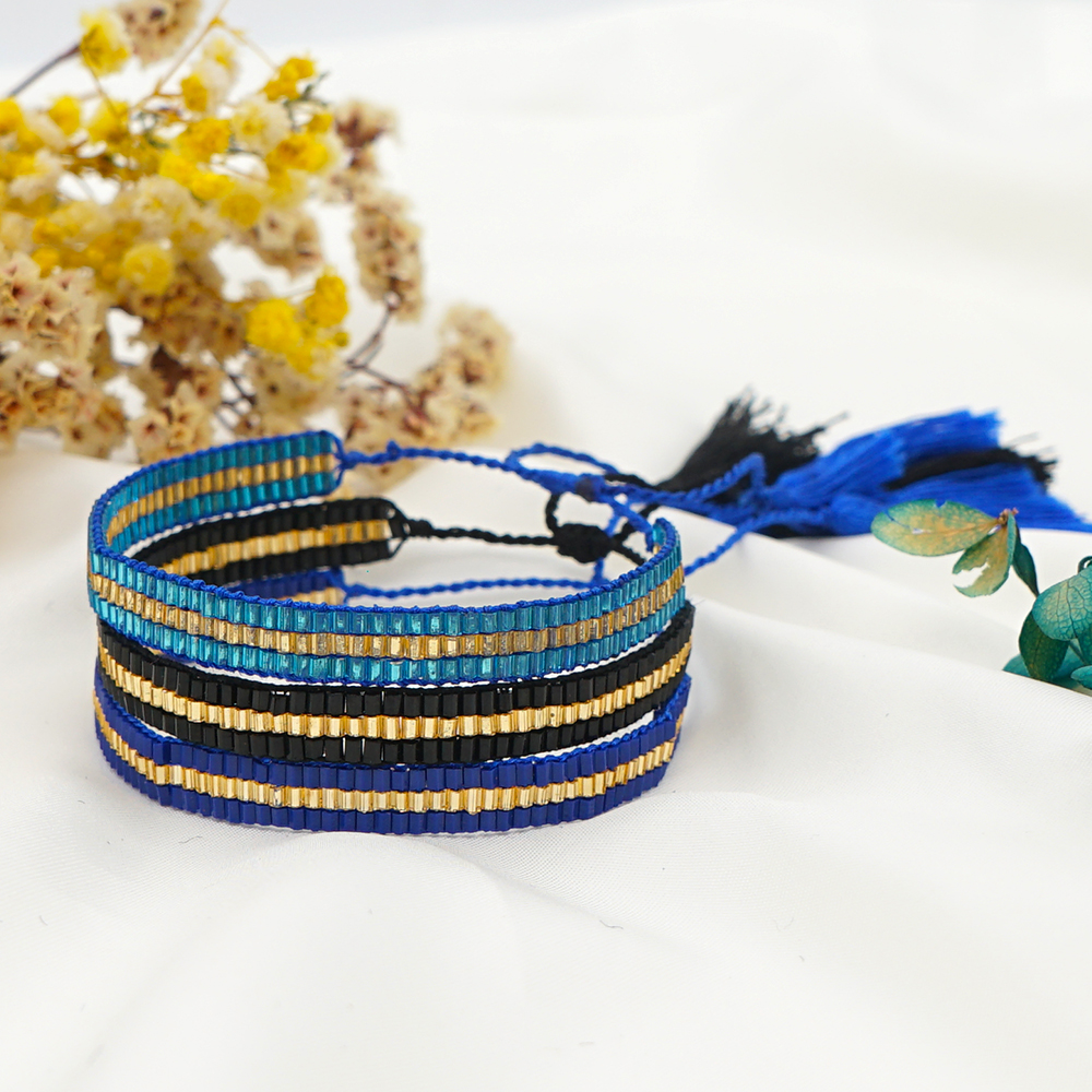 Glass beads spun with a blowtorch Murano glass. Glass ball and leather bracelet
