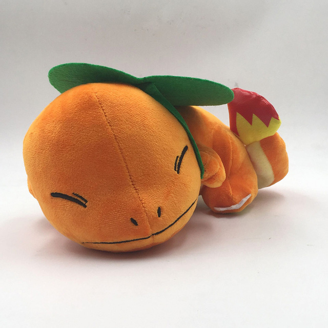 Peluche de Charmander escondiéndose de la lluvia Merchandising de Pokémon Peluches de Pokémon