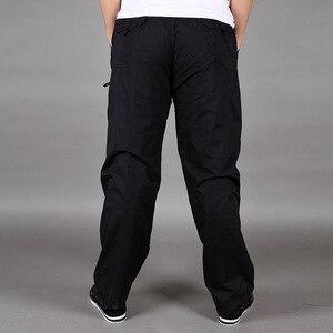 Image 4 - Pantalones gruesos de terciopelo para invierno, algodón, holgados, de gran tamaño, rectos, con múltiples bolsillos, para herramientas