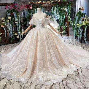 Image 1 - AXJFU Luxury princess champagne lace ruffles boat neck beading crystal star sparkly dubai wedding dress 100% real photo1499/1000