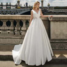 Unikalne satyna dekolt w kształcie litery a suknie ślubne z paciorkami suknie ślubne bez rękawów Vestido de Noiva Custom Made suknia balowa
