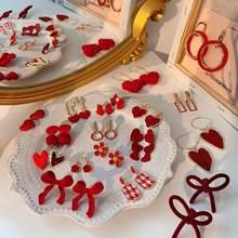 Orecchini a bottone da donna stile autunno inverno Pompon rosso gioielli moda sposa Eardrop in metallo dolce ragazza regalo regalo orecchio decorazione