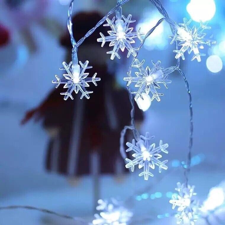 Luzes da corda do floco de neve