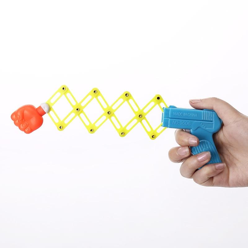 Kids Toy Jokes Retractable Fist Gun Prank Gadgets Sensory Autism Gag Shocking Novelty Gifts