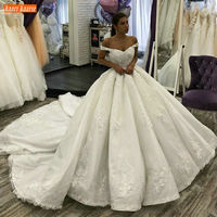 Luxury African White Wedding Gowns Off Shoulder Appliqued Lace Pearls Princess Bridal Dress Custom Made Arabic Wedding Dresses