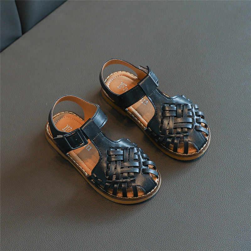 รองเท้าแตะชายหญิงตัด outs รองเท้าหนัง 2020 ฤดูร้อนใหม่รองเท้าแตะ Gladiator สานเด็กสาวชายหาด d02043
