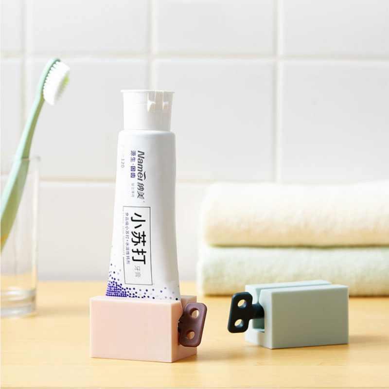 מדריך מתגלגל צינור משחת שיניים מסחטת המותח משחת שיניים מושב בעל מתקן עמדת עבור קרמים משחה להדביק