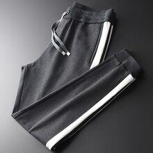 Minglu kalın erkek pantolon lüks şerit kontrast renk Splice Casual spor erkek pantolon artı boyutu 4xl elastik bel erkek pantolon