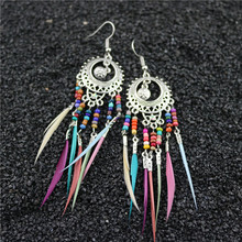 Hello Miss2019 new personality exaggerated earrings bohemian hollow colorful rice beads feather tassel womens