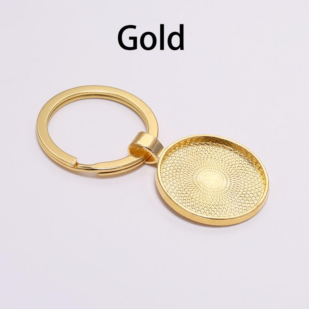 Gold Toned Etched Oval Chinese Yuan Currency Sign Pendant Keychain