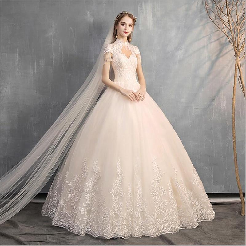 Lace Wedding Dresses 2020 Cap Sleeves Appliques Tassel High Neck Bride Dress Princess Wedding Gown Ball Gown Robe De Mariee 2020