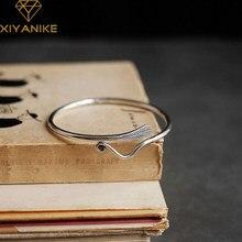 XIYANIKE de Plata de Ley 925 gran oferta de pluma de pavo real pulsera Retro cuero patrón moda hecho a mano regalo par ajustable