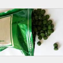 Tabletas originales de algas verdes tabletas de chlorella proteína alcalina rota de alimentos chlorella 1000 unids/caja