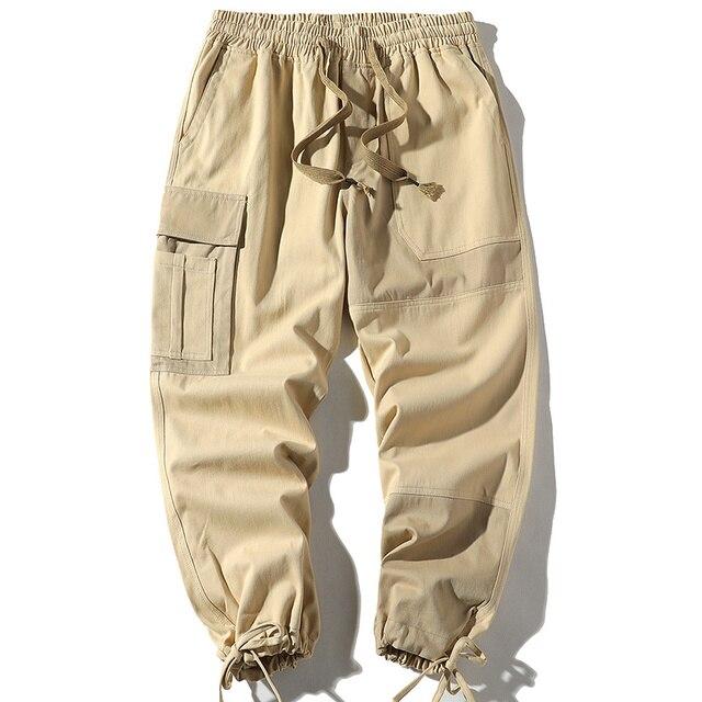 Фото уличная одежда с карманами в стиле хип хоп лентами брюки карго