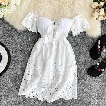 цена на 2020 Summer White Dress Hollow Lace V-neck Chest Pad Open-back Flared Sleeve Short Dress Summer