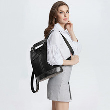Women's bag 2020 new fashion bead leather backpack female personality lock anti-theft large-capacity travel backpack