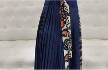 فستان صيفي أنيق مطرز بتنورة بيليسه موديل راقي