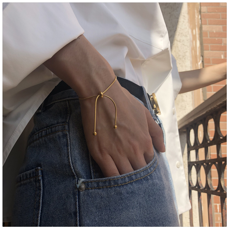 HUANZHI 2020 Simple Design Gold Color Snake Chain Bangle Pull-out Adjustable Bracelet for Women Girl Men Beads Jewelry 22cm