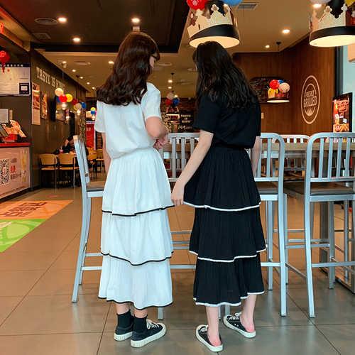 Été nouvelle couleur unie en mousseline de soie jupe femme noir blanc taille haute fête volants à plusieurs niveaux doux gâteau jupe