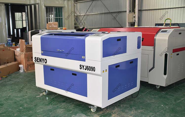 จีนยอดนิยมแกะสลักเลเซอร์ 6090/เลเซอร์แกะสลักเครื่อง 6090/เลเซอร์เครื่องเย็บปักถักร้อยราคา