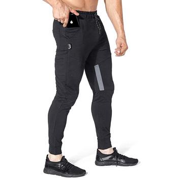 Nowe markowe spodnie do joggingu męskie spodnie sportowe spodnie do biegania męskie spodnie do biegania Fitness spodnie do biegania dopasowane obcisłe spodnie kulturystyka spodnie tanie i dobre opinie Ołówek spodnie Mieszkanie Poliester Skrzydeł REGULAR 0 - 0 Pełnej długości Na co dzień Midweight Suknem Elastyczny pas