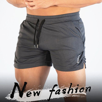 2019 New Summer Male Fitness Bodybuilding brand shorts Mesh Breathable Quick-drying Fashion Casual Joggers 4XL-shorts Sportswear 2