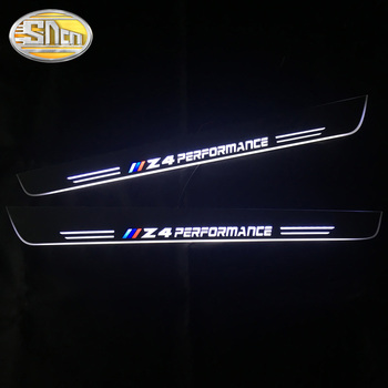 цена на SNCN 2PCS Waterproof Acrylic Moving LED Welcome Pedal Car Scuff Plate Pedal Door Sill Pathway Light For BMW Z4 E85 E86 E89