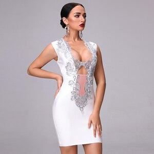 Image 2 - 2020 새로운 가을 고품질의 흰색 검은 민소매 깊은 v 목 장식 조각 중공 붕대 드레스 나이트 클럽 파티 크리스마스 드레스