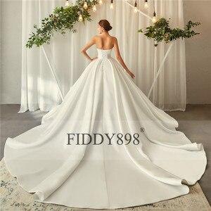 Image 2 - ロイヤルウェディングドレス 2020 V ネックソフトサテンのウェディングドレスふくらん夜会服フリルブライダルガウンロングトレイン Vestido デ noiva