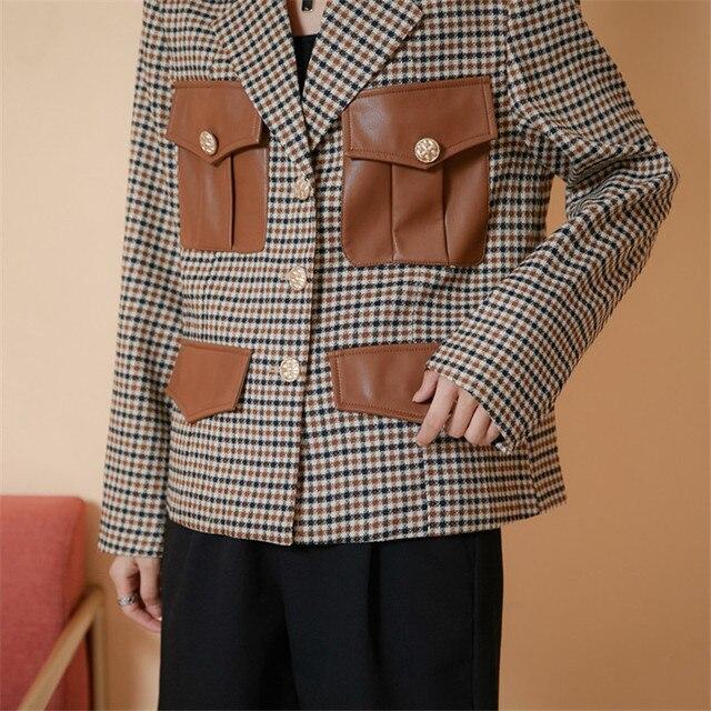 шикарная универсальная клетчатая куртка в английском стиле с фотография