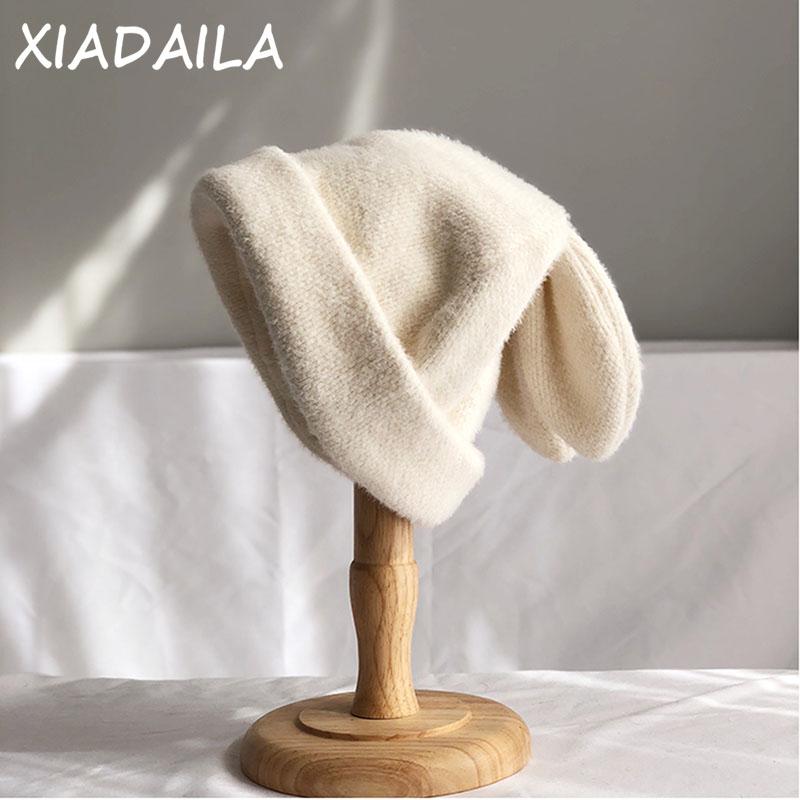 Draping rabbit ears rabbit fur hat women autumn and winter knitted wool hat winter warm Korean version of Japanese hat