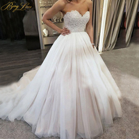 BeryLove Puffy A line Wedding Dress 2019 Crystal Belt Pearls Beaded Bodice Sweetheart Tulle Bridal Dress Bride Marriage