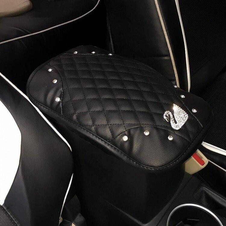 Cubierta del asiento de la caja del reposabrazos del automóvil conjunto de diamantes del cisne de las mujeres montado en el coche Universal del apoyabrazos Central del coche entre