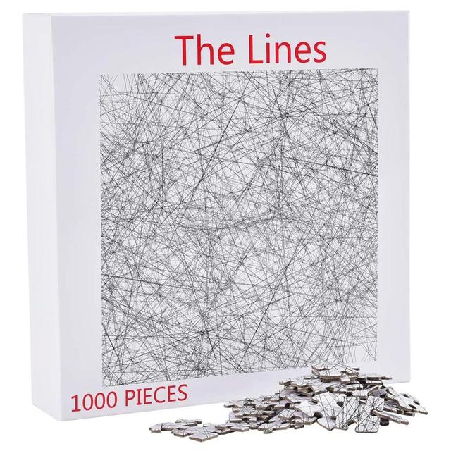 The box and pieces to the 1000 piece version of the lines puzzle