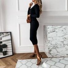 Женское трикотажное платье свитер средней длины с v образным