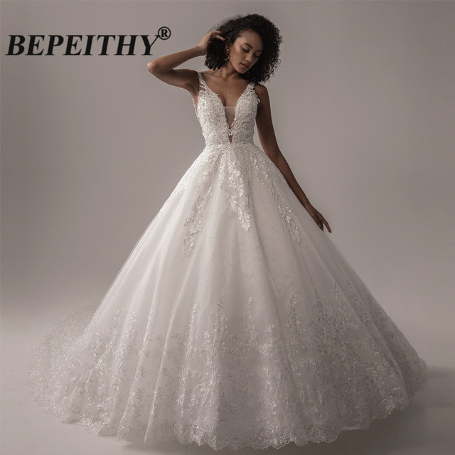 BEPEITHY Deep V Neck Lace Wedding Dress 2021 Ball Gown Bridal Court Train Sleeveless Women Indian Ivory Wedding Bouquet Gown New 1