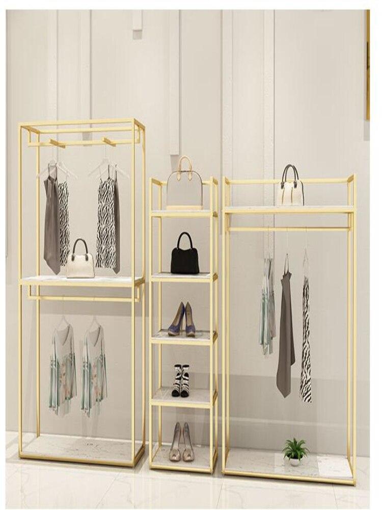 Etagère murale pour magasin de vêtements femmes en or | Présentoir mural pour magasin de vêtements type sol, étagère pour vêtements design de magasin