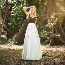 Элегантное черно белое женское платье А силуэта с открытыми