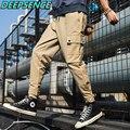 2021; Сезон весна-осень; Повседневные брюки-карго для мужчин хлопок сплошной шнурок карманами в Корейском стиле Модные свободный крой ботильо...