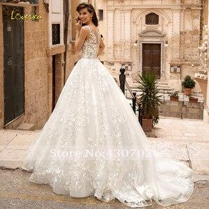 Image 2 - Loverxu V Neck A Line Lace Wedding Dresses Delicate Appliques Cap Sleeve Button Bride Dresses Court Train Bridal Gowns Plus Size