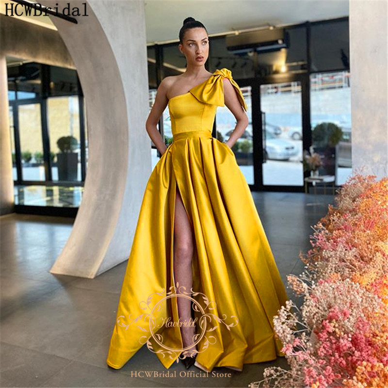 Golden One Shoulder Long Prom Dresses With Bow High Slit A Line Plus Size Satin Formal Dresses For Graduation With Pockets