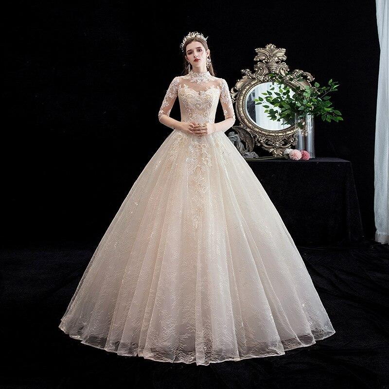Gorgeous Applique Lace Wedding Dresses Elegant Champagne Color Wedding Dress Sexy Nail Bead Princess Bride Wedding Gown