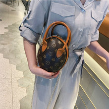 Senior leather bag 2019 new Jurassic dinosaur egg backpack wild fashion printing chain shoulder diagonal handbag