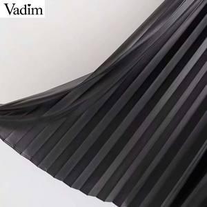 Image 5 - Vadim kobiety PU skóra spódnica wiązana guziki nieregularny projekt spódnice czarny kobiet chic do połowy łydki plisowana spódnica mujer BA811